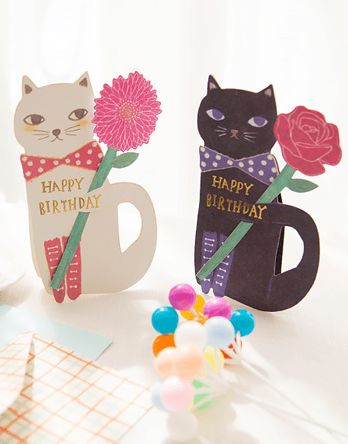 Cat With Flower Standing Birthday Card